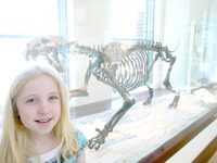 Zoe - Saber-Tooth Fossil & Zoe at LA Cty Museum 2010